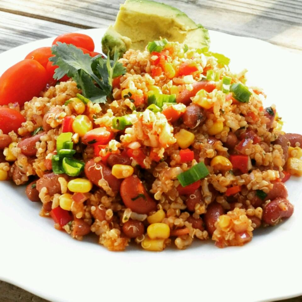"This one is inspired by Mexican flavors. ""Extremely yummy, spicy marinated salad that will keep in the fridge for up to a week,"" says Rita. ""You have everything you need for a very healthy meal in one dish! Substitute barley for the brown rice if desired. Turtle beans can be substituted for kidney beans."""