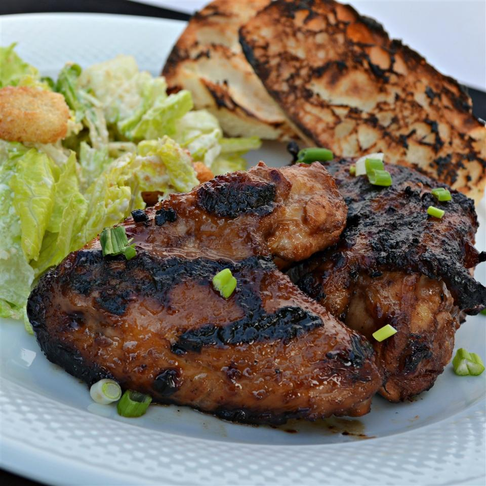"""For this Hawaiian barbeque chicken, crushed pineapple and brown sugar create a delicious marinade that caramelizes beautifully on the grill. """"This Hawaiian BBQ is commonly found at roadside fundraisers,"""" says Mark Bender. """"This recipe uses crushed pineapple and brown sugar for caramelized texture and wonderful flavor. And, if you are wondering, 'huli' is the Hawaiian term for 'turn.'"""""""