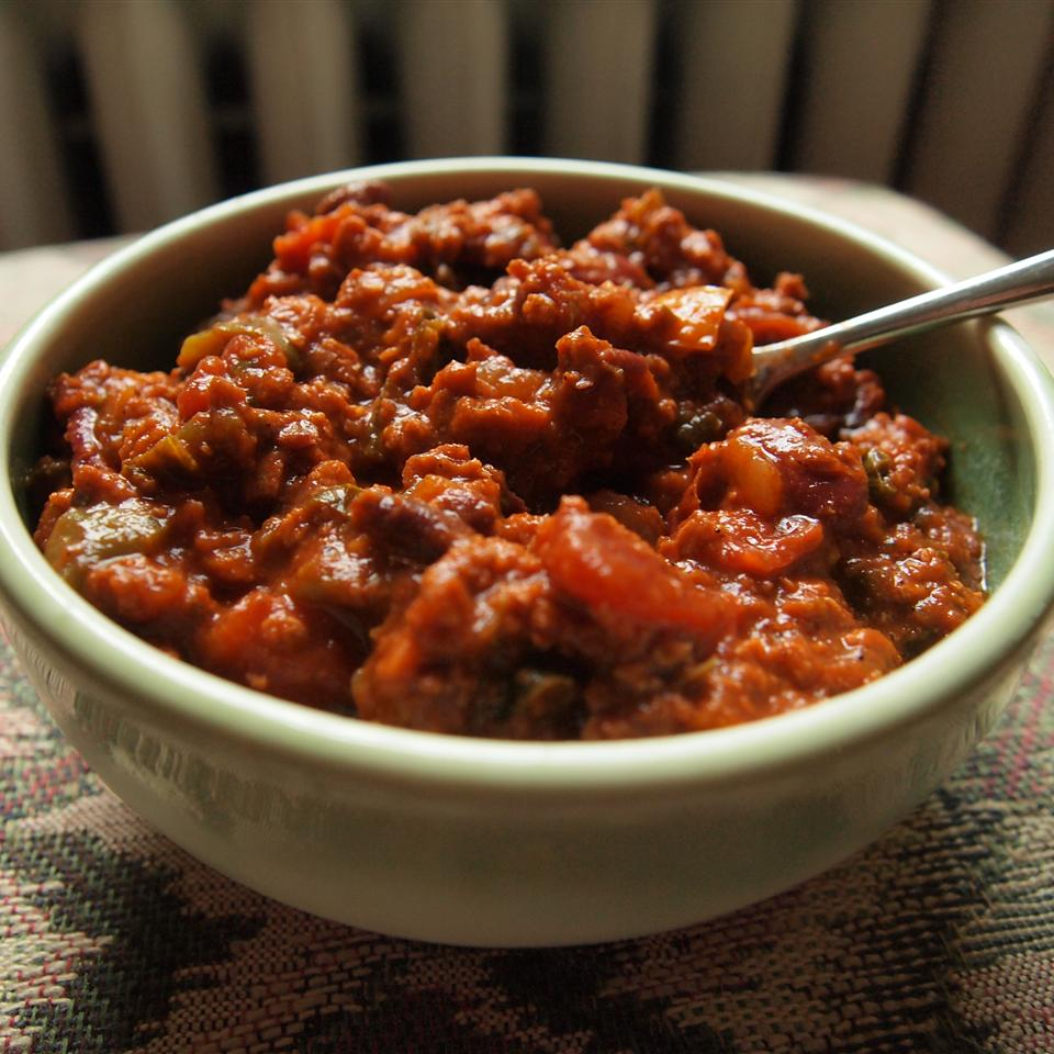 """This is a thick, hearty vegetarian chili that is a hit at parties even among die-hard meat eaters,"" says J. Phillips. ""The TVP gives it the texture of ground beef, and the chiles give it a nice depth of flavor. Cook it in the slow cooker or on the stovetop. I find this tastes best after sitting in the fridge overnight and reheating the next day. Serve with grated cheese on top."""