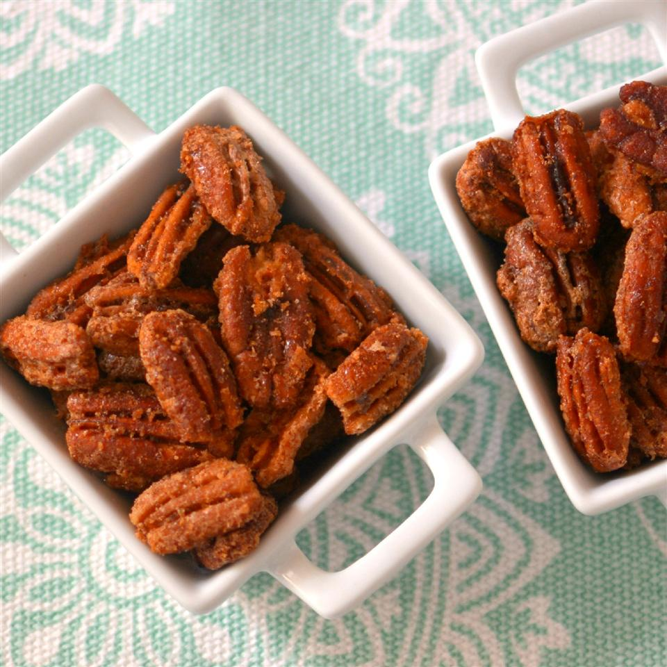 "Nothing fills the house with holiday scents quote like roasting spiced nuts in the kitchen. Erin, the recipe creator for these cinnamon pecans, says ""My grandma makes these every year for the holidays. It's always handy to make extra for later snacking!"""