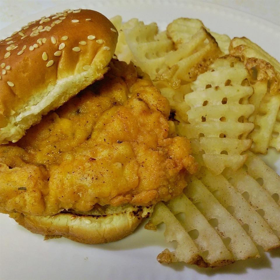 "Reviewer Robyn Costello gave this fried chicken sandwich recipe 5 stars: ""Everyone loved the crispy, juicy chicken. Everyone could make their own sandwich how they like it. I was surprised how easy it was to make. This will certainly be added to my favorite list!"""