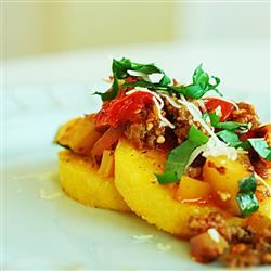 Polenta with Spicy Sausage-Veggie Sauce dabblingdiva