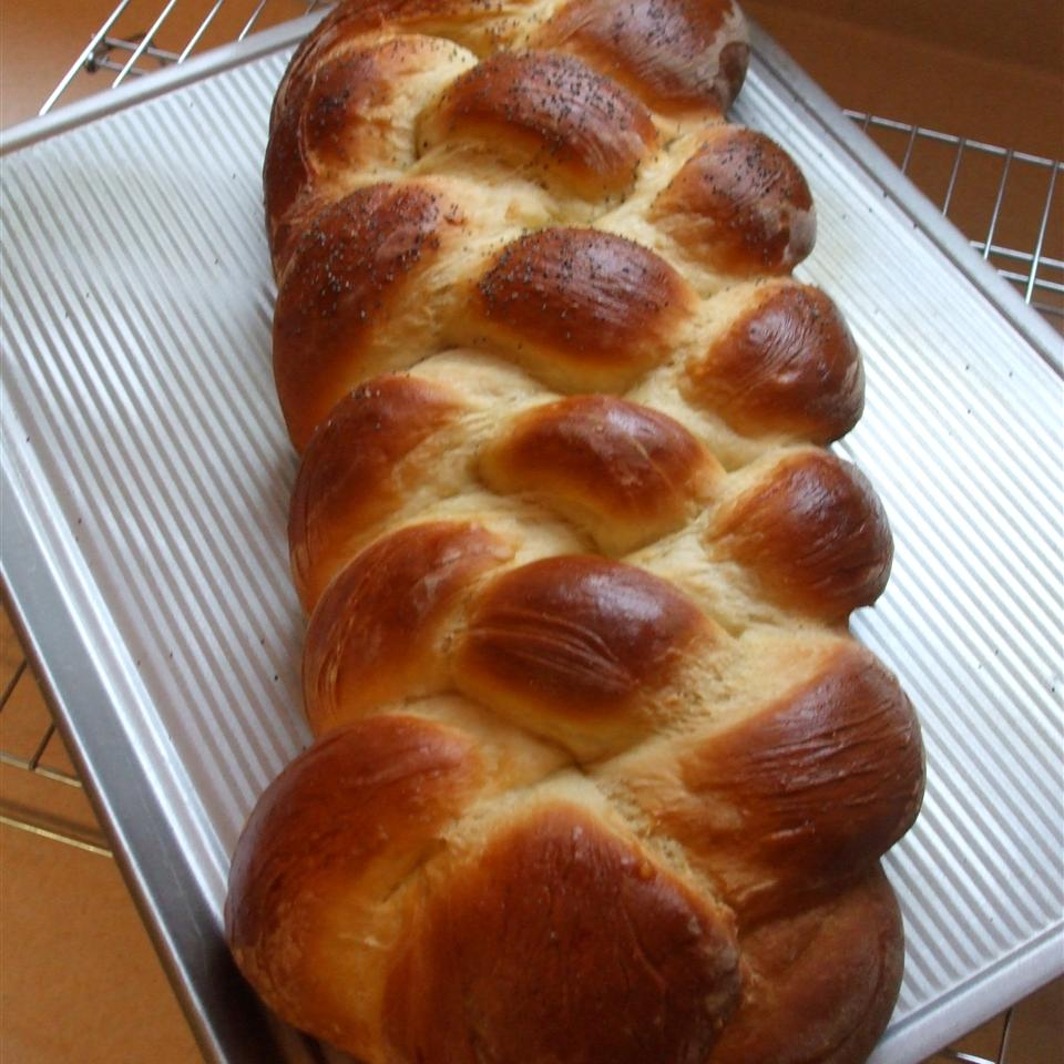 A very simple egg-enriched yeast bread dough is divided into four ropes and braided to form an elegant loaf. Brush with egg wash and sprinkle with poppy seeds before baking.
