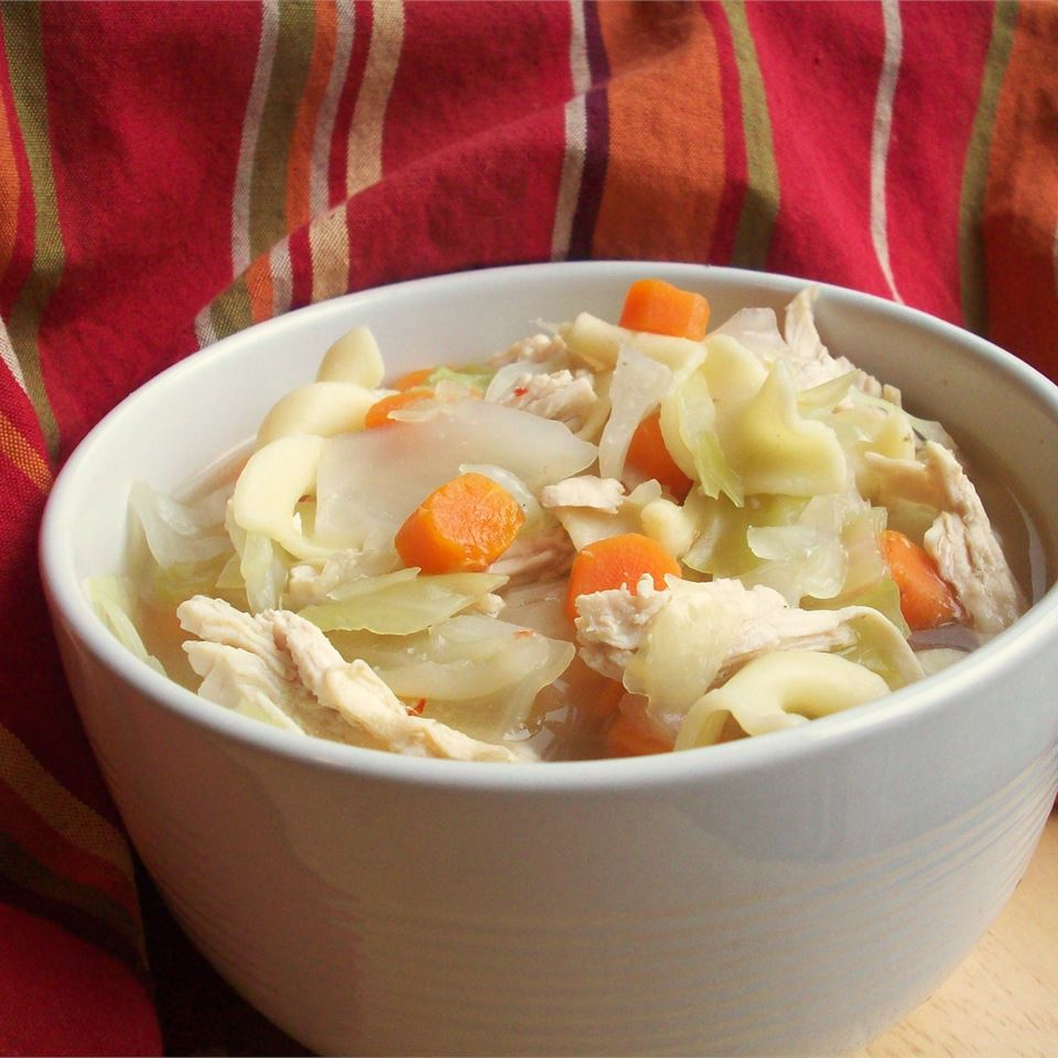 """Here's a low-fat, low-calorie chicken soup with cabbage and egg noodles. The soup should be thick like a stew. Serve hot and flavor to taste with Thai chili sauce. """"Excellent!"""" raves DuVallKD. """"Added a couple extra thai peppers and lemongrass and used Amish egg noodles. Can't get enough, will definitely make again."""""""