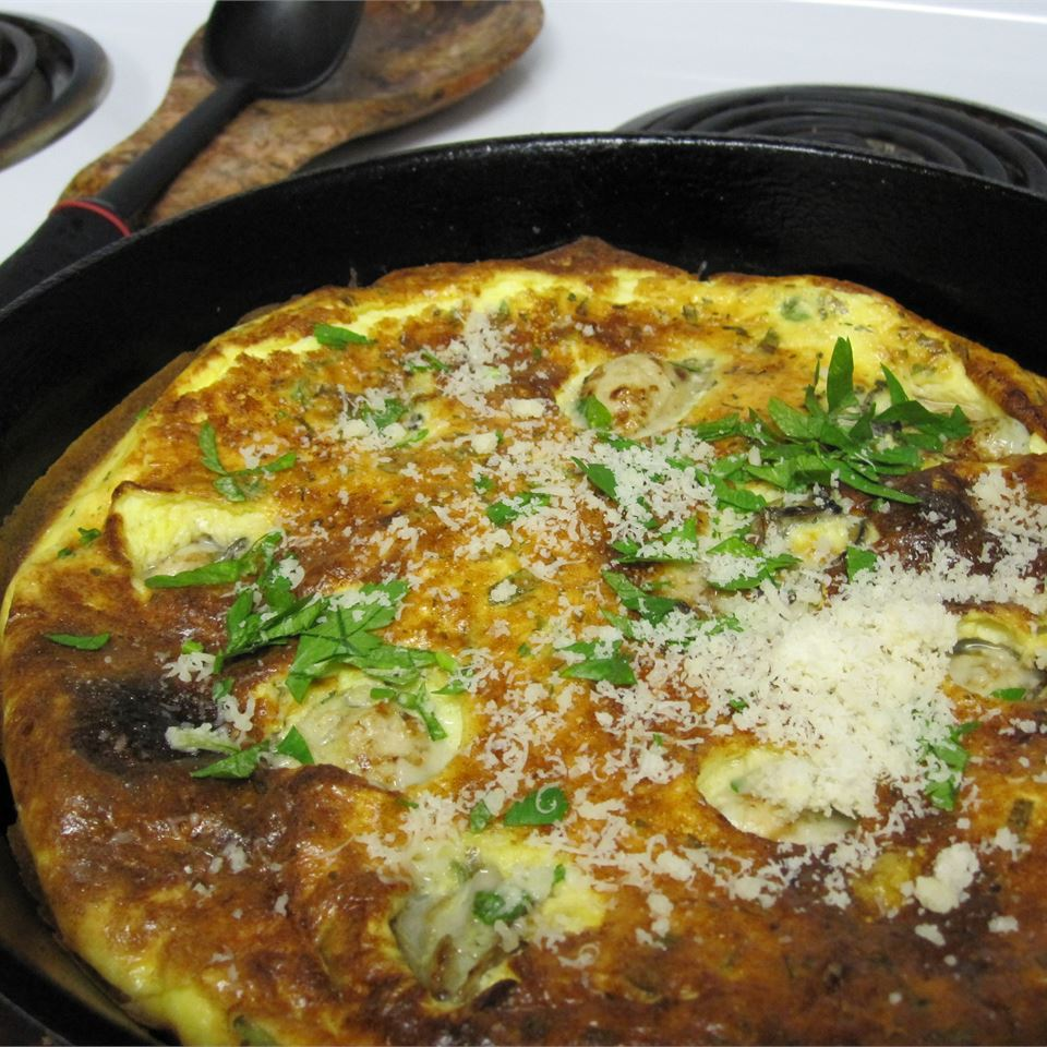 "The Hangtown Fry was popularized during the California Gold Rush. ""My variation on the traditional Hangtown Fry contains cheese and fresh herbs and is finished under the broiler where the egg/oyster mixture puffs up like a cross between a frittata and a souffle,"" says Cazuela. ""I get the best results using a cast iron skillet."""