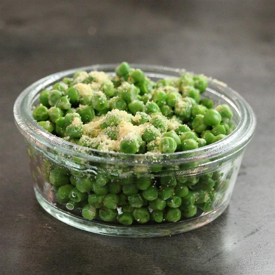 """Frozen peas are microwaved and seasoned with an Italian cheese blend, nutritional yeast, and garlic powder. """"Easy peasy that's for sure,"""" says Buckwheat Queen. """"Mine only needed 2 minutes at 900W. I made these using Parmigiano-Reggiano instead of the blend. I also made a vegan batch using vegan 'grated cheese' (nutritional yeast and almond flour) and loved both. Hot red peppers make a nice addition."""""""