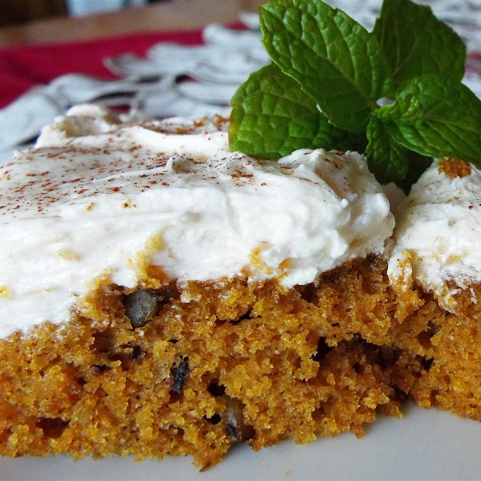 For the best flavor, moist and lightly spiced pumpkin bars should be kept refrigerated for a few days before serving, which makes them ideal for a make-ahead dessert. If you don't have a jelly roll pan, Jamie A. says the recipes also work great in a 9x13-inch baking pan. Just make sure to add 10 minutes of bake time so the cake is cooked all the way through. You could freeze the bars after frosting them if you freeze them on a baking sheet until the frosting is hard, then wrap well and stick them back in the freezer.
