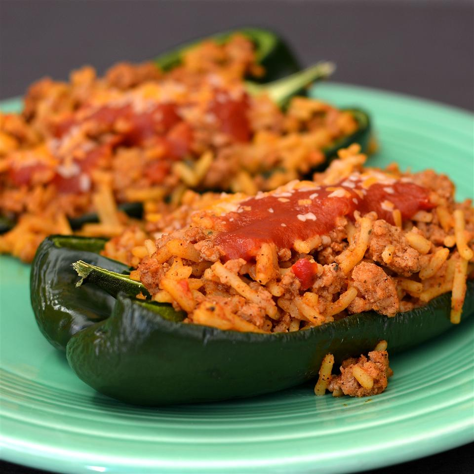 "Poblano peppers are stuffed with ground beef and Spanish rice and baked in a tomato soup-based sauce topped with shredded mozzarella cheese. ""American comfort food done up Latin-American style,"" says IBETRAVLIN. ""We used boxed Spanish rice, but there are a number of good recipes on this site (Spanish Rice II and Best Spanish Rice) that I have used with good results. Serve with garnishments of choice: shredded lettuce, diced tomatoes, sour cream, guacamole, and salsa."""