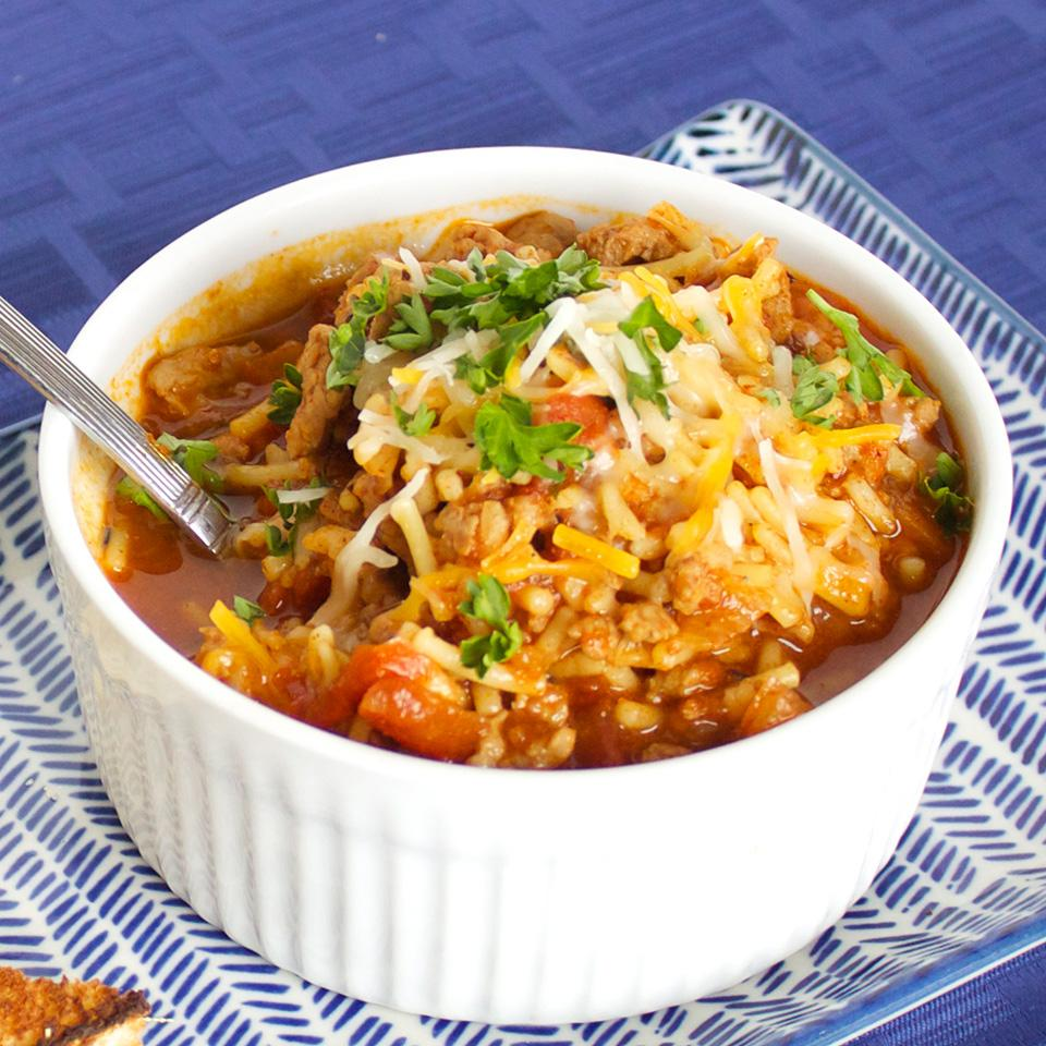 """Seasoned ground turkey, fire-roasted tomatoes, and Spanish-seasoned rice feature in this crowd-pleasing chili. """"Take your chili to the next level with this quick-to-make savory turkey chili,"""" says thedailygourmet. """"You can top the chili with sour cream or grated cheese if you like."""""""