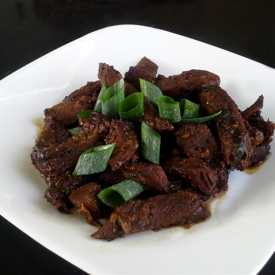 Beef is marinated in soy sauce, sesame oil, sugar, and garlic then slow-cooked to tender perfection in this easy recipe for Korean Bulgogi.