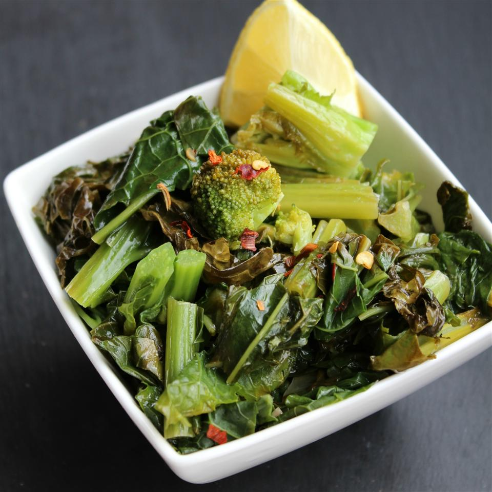 """This simple but tasty Sicilian-style side dish ready in minutes. You'll saute broccoli rabe in olive oil with garlic and red pepper flakes. """"This is the way broccoli rabe was meant to be cooked,"""" saysiMakeItRainInTheKitchen. """"This goes great with a nice steak or fish. Serve with crusty Italian bread and some good vino. The best part is dipping the crusty bread in those juices. Buon appetito!"""""""