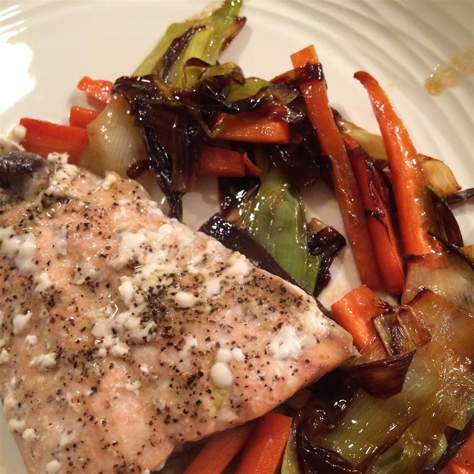 "You'll top this simple baked salmon fillets with caramelized leeks and matchstick carrots. Louisville Hugger rates this recipe ""5 stars every time. What can I say about these leeks? They cook up beautifully with the carrots and the smell is outstanding."""