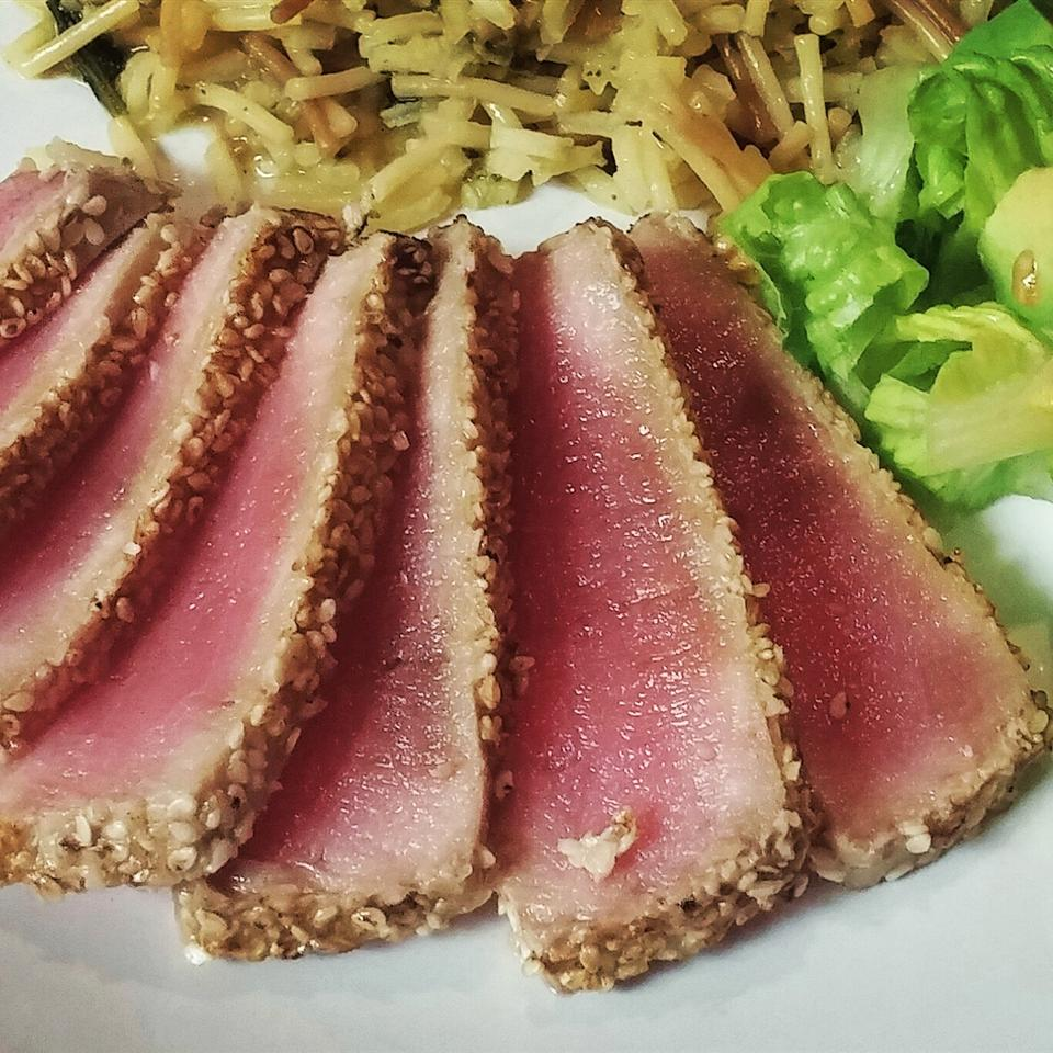 "Tuna steaks are coated with sesame seeds and quickly seared and served with wasabi and a dipping sauce of  soy sauce, mirin, rice vinegar, honey, and sesame oil. . ""This tuna is served rare, so be sure to use a good quality fresh tuna,"" says NEWORLEANSGIGLET."