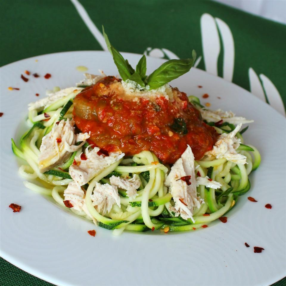 "Cubes of cooked chicken breast and homemade roasted red pepper sauce perch on a bed of spiral-sliced zucchini and summer squash. ""Zucchini subs in for traditional pasta in this great veggie-rich dish,"" says Volleyballmom."