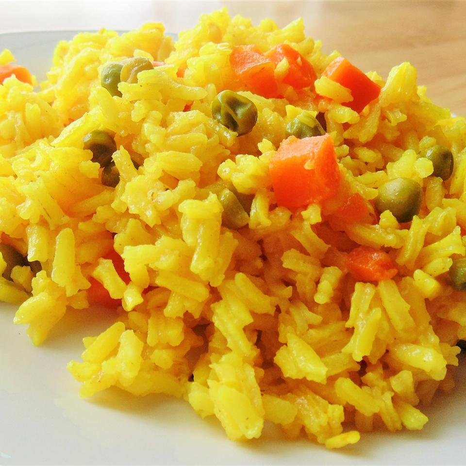 Turmeric Rice with Peas and Carrots Nevine A. Abaza