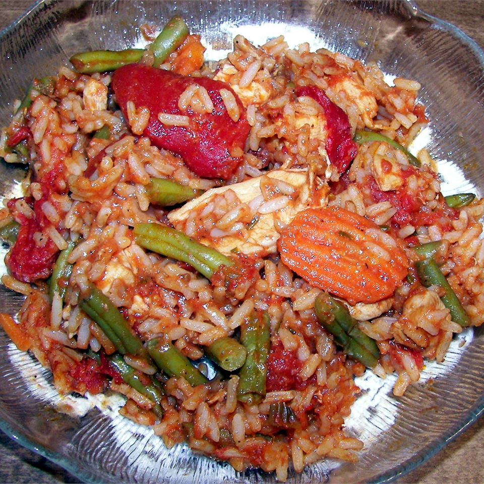 Here's a popular and spicy West African chicken and rice recipe. With fresh green beans and carrots, it's a complete meal in one pan.