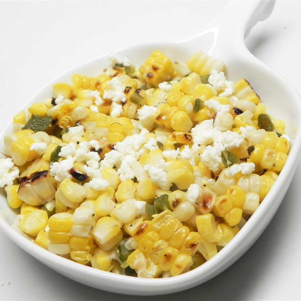 Grilled corn, a Hatch chile pepper, and goat cheese get all zesty together with a squeeze of fresh lime juice to make a simple salad with a big punch of flavor.