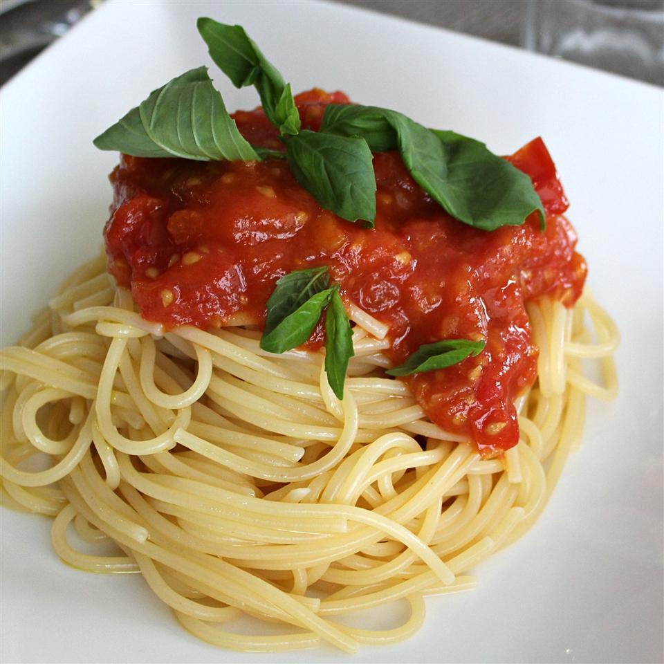 """This simple spaghetti sauce is made with fresh tomatoes. """"Wonderful taste,"""" says Susan Bryan Willingham. """"Serve over spaghetti noodles and add grated Parmesan cheese as desired."""""""