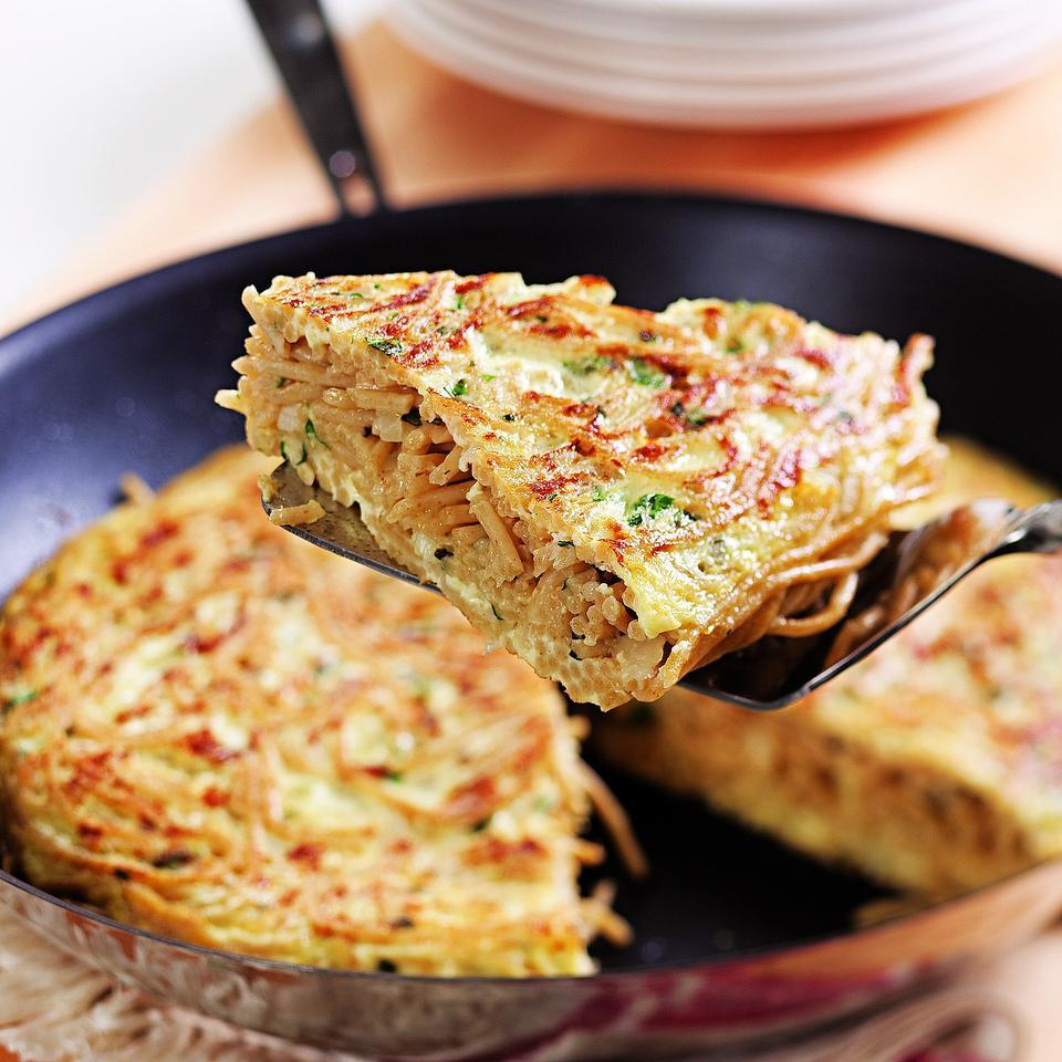 Here's a creative way to use leftover cooked spaghetti: try mixing it with eggs for a filling Italian omelet. If you don't want to buy separate bunches of fresh herbs, look for an Italian blend package that may contain some of each or use one-third the amount of dried. Source: EatingWell Magazine, September/October 2010