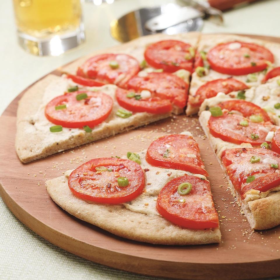 A fragrant white bean puree and fresh tomato slices top this crisp pizza.