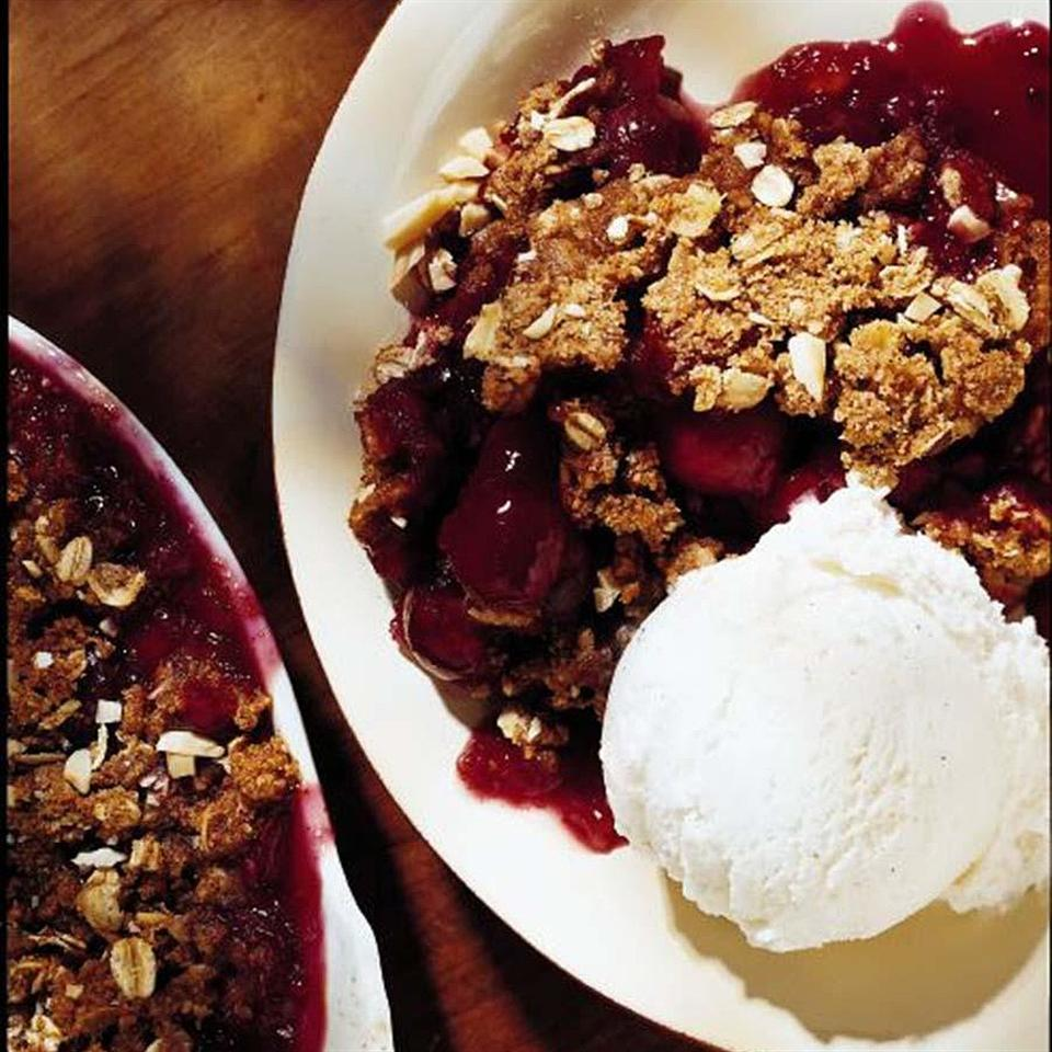 A fruit crisp offers the luscious flavor of a fresh fruit pie without the fuss of making a crust. Celebrate the arrival of cherries with this rich-tasting crisp. The nut-studded topping works great with other fruit combinations too.