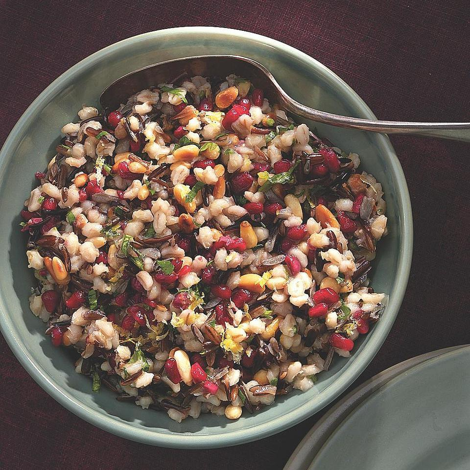 This pilaf melds the chewy texture of barley and wild rice with the richness of toasted pine nuts and the sweet-sour crunch of pomegranate seeds. The elegant dish is perfect for entertaining.