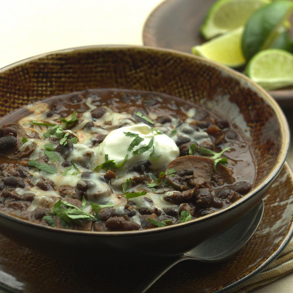 Black beans, earthy mushrooms and tangy tomatillos combine with a variety of spices and smoky chipotles to create a fantastic full-flavored chili. It can simmer in the slow cooker all day, which makes it perfect for a healthy supper when the end of your day is rushed. Source: EatingWell Magazine, Winter 2004