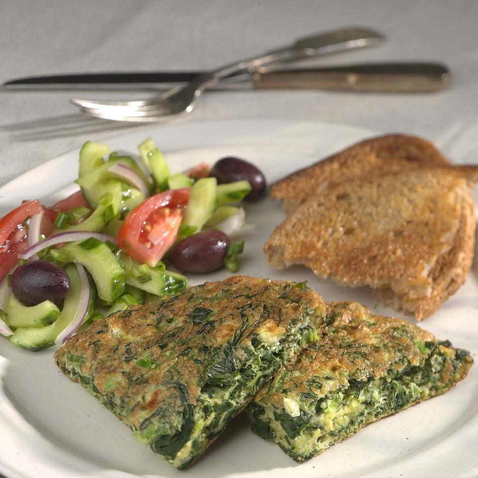 With flavors reminiscent of the classic Greek spanakopita, this easy omelet is just right for a light dinner or brunch. Frozen leaf spinach makes it ultra-quick.