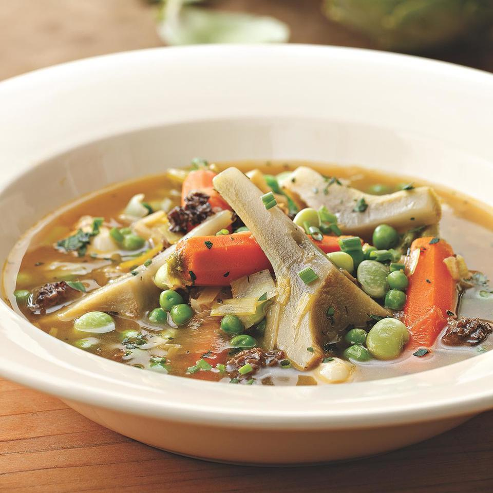 This rich, satisfying vegetable stew celebrates the first vegetables of spring--artichokes, leeks, carrots and peas. For a truly indulgent flair, omit the butter at the end and drizzle each serving with a little truffle oil.