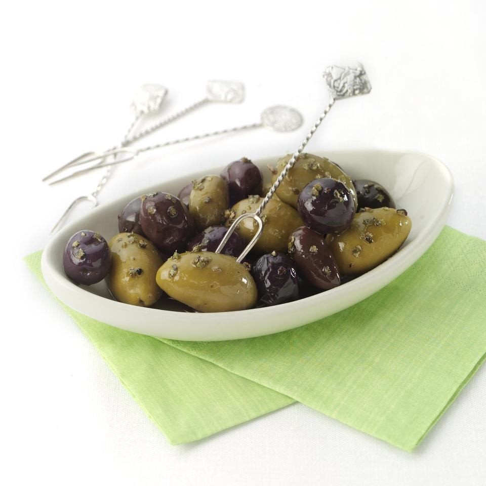 Dried herbs and crushed garlic dress up your favorite olives.