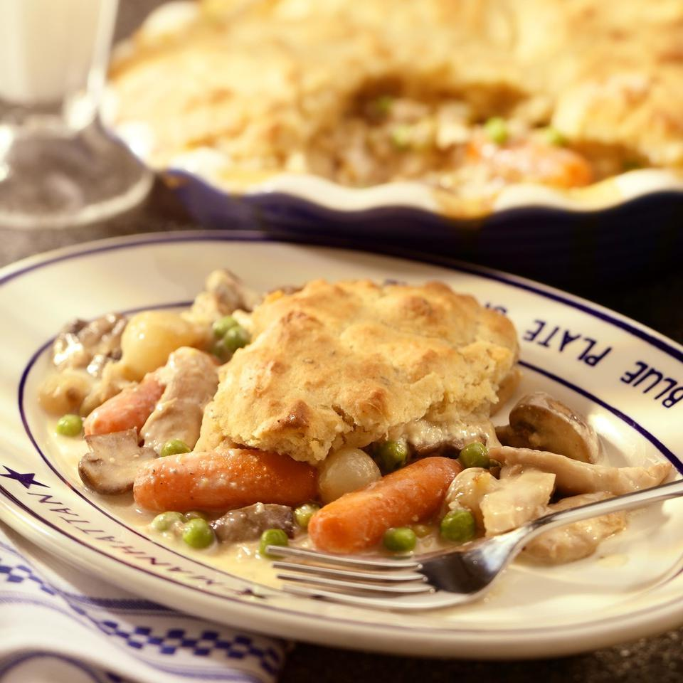 This chicken potpie is studded with peas, mushrooms, carrots and onions and topped with tender whole-wheat biscuits. The savory sauce gets a rich taste from reduced-fat sour cream, but with less fat and calories. And it ends up just as delicious and comforting as you expect.