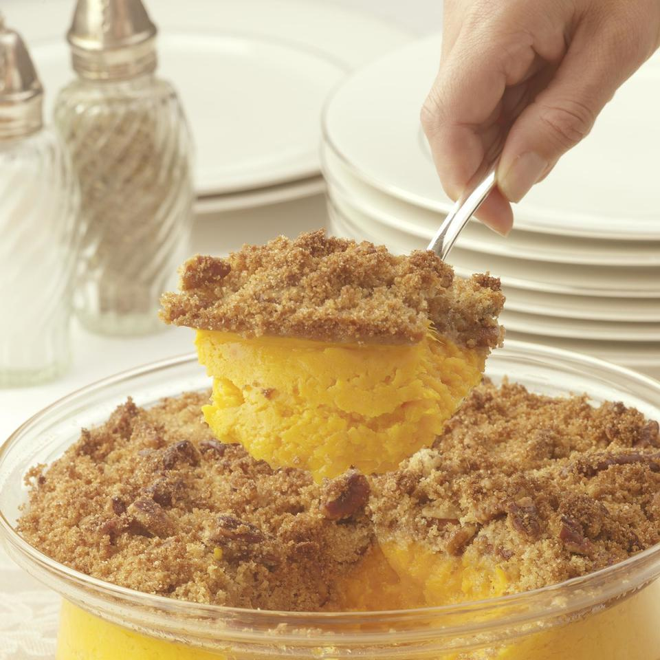 This scrumptious sweet potato casserole gets fabulous flavor from honey and freshly grated orange zest rather than the traditional stick of butter. To complete the healthy makeover we sprinkle a crunchy pecan streusel spiked with orange juice concentrate over the top. You can save the marshmallows for s'mores.