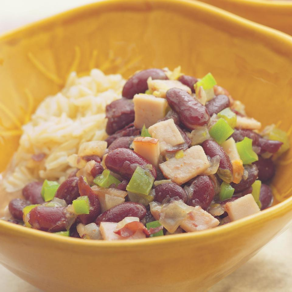 This quick version of red beans and rice gets its smoky goodness from super-lean Canadian bacon and a hit of ground chipotle pepper. It's delicious as a leftover but will thicken as it stands. To keep it properly syrupy, just thin with a little water and reheat. Source: EatingWell Magazine, April/May 2005