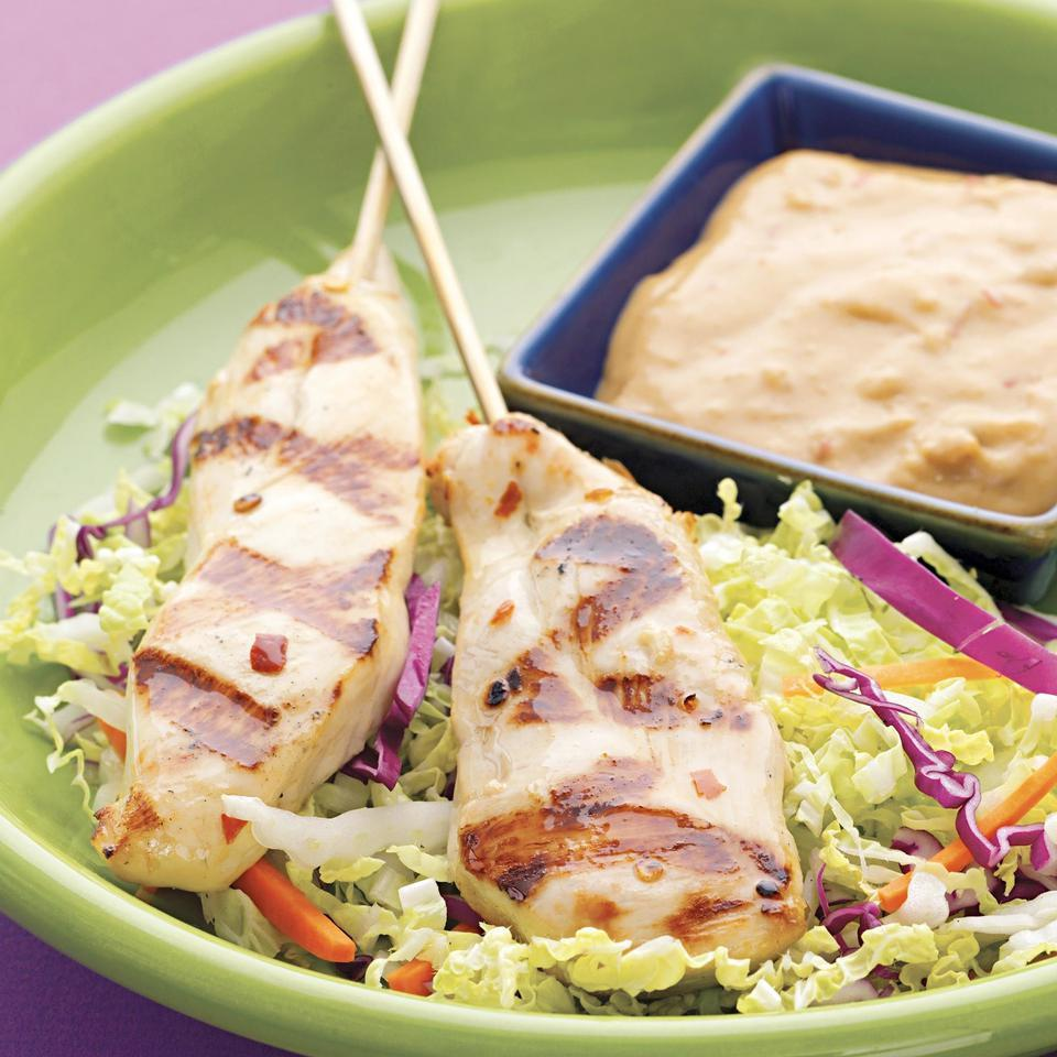 Spicy peanut sauce is the perfect match for these Thai-marinated grilled chicken strips.