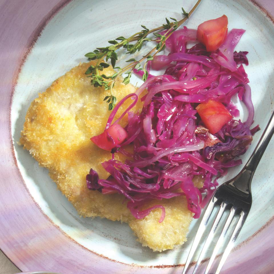 Pork and apples and red cabbage are meant for each other. Here all three appear in a mélange that brings together the Japanese tradition of panko-crusted pork chops with the New England tradition of seasoning with maple syrup and cider vinegar. Serve with a wild rice pilaf.