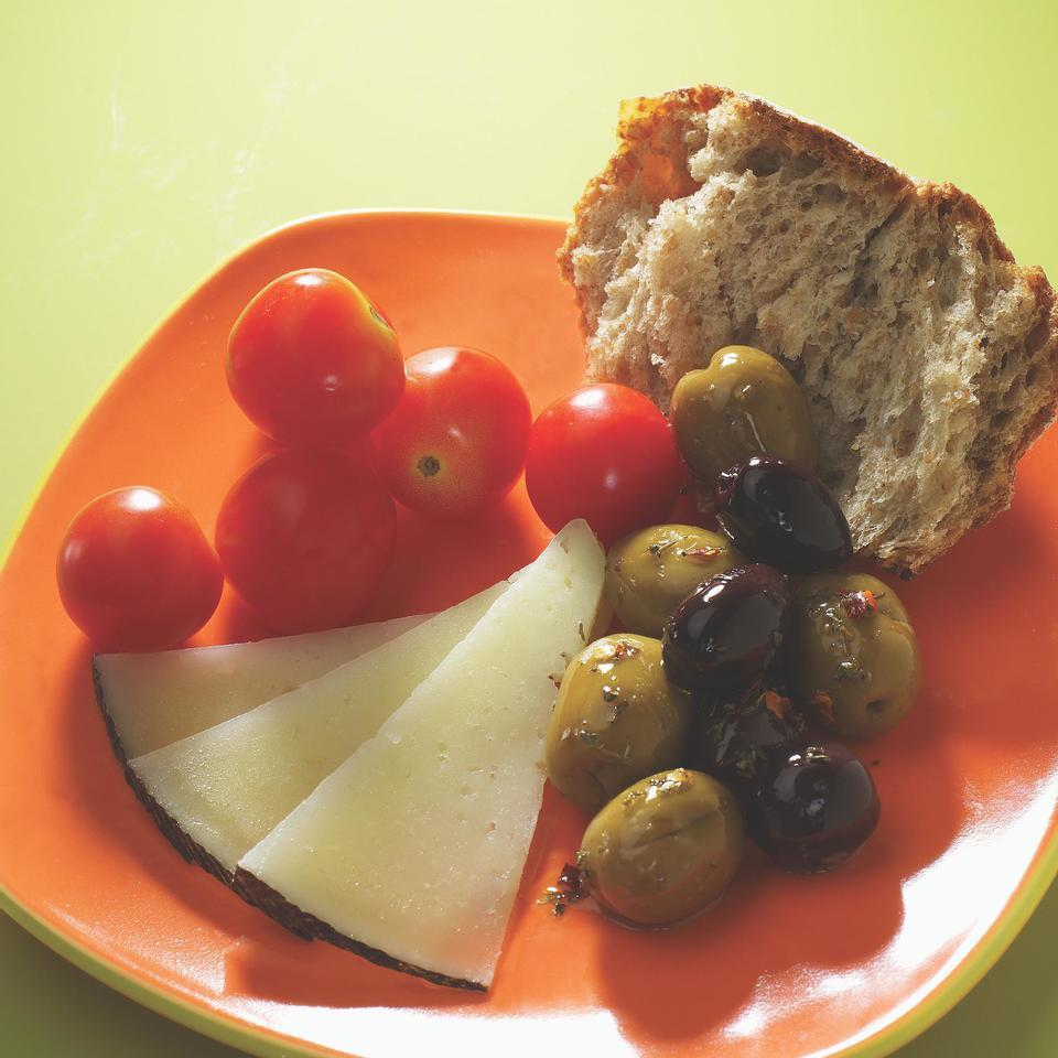 Sweet tomatoes, salty olives and tangy cheese are a perfect afternoon pick-me-up. Source: EatingWell Magazine, October/November 2005