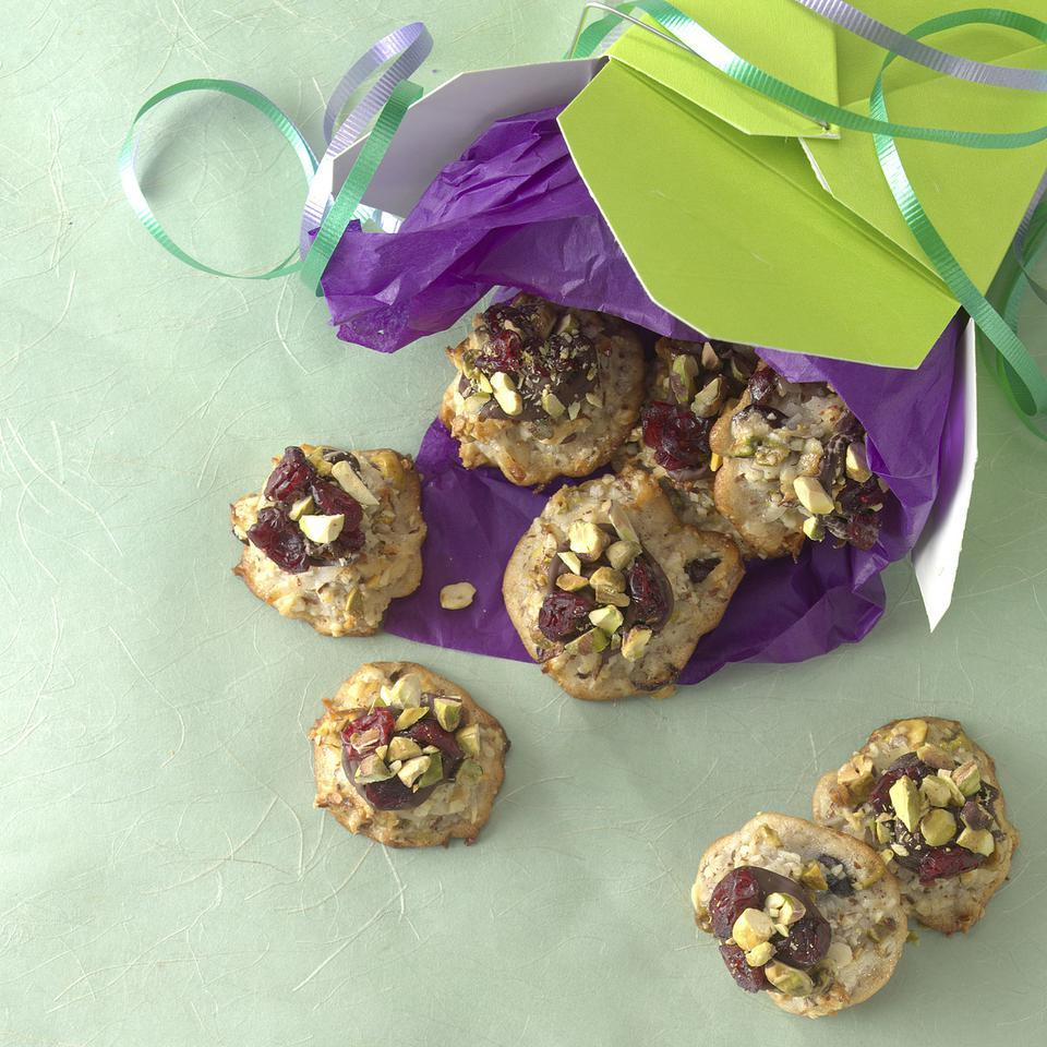 These luxurious macaroons studded with pistachios and dried cranberries hail from food stylist Katie Webster. She made them three years ago when she was a personal chef for a gluten-intolerant client, then began selling them to a grateful crowd at her local farmers' market. Although you can concoct them with either sweetened or unsweetened coconut, we find that the unsweetened packs a more coconutty wallop. For a variation, substitute chopped crystallized ginger and mini chocolate chips for the pistachios and cranberries.