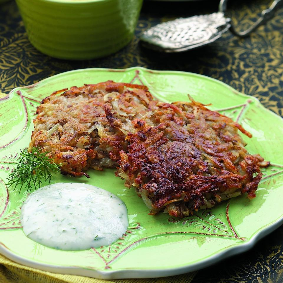 It is a holiday tradition to fry latkes in hot oil, but here shredded potato-and-onion pancakes get a coating of matzo crumbs, then are pan-fried in a small amount of oil and finished in a hot oven for a few minutes. The golden-crisp results have only 4 grams of fat and 100 calories per serving—truly a miracle.