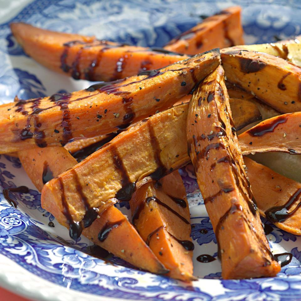 A delicious tangy-sweet balsamic-and-honey reduction looks dramatic over roasted sweet potato wedges.