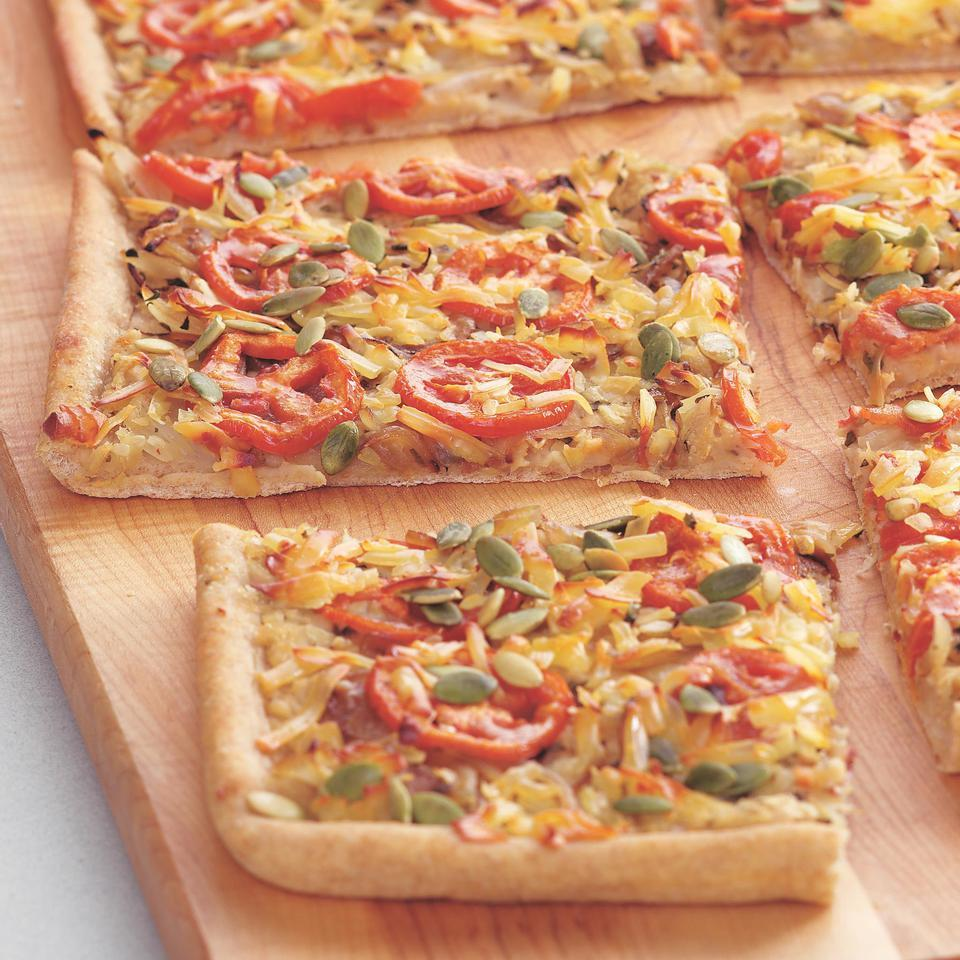 Here we top pizza with herbed mashed beans, sliced plum tomatoes, sweet caramelized onions and some shredded Gouda for a tasty flatbread that will have you rethinking pizza toppings.