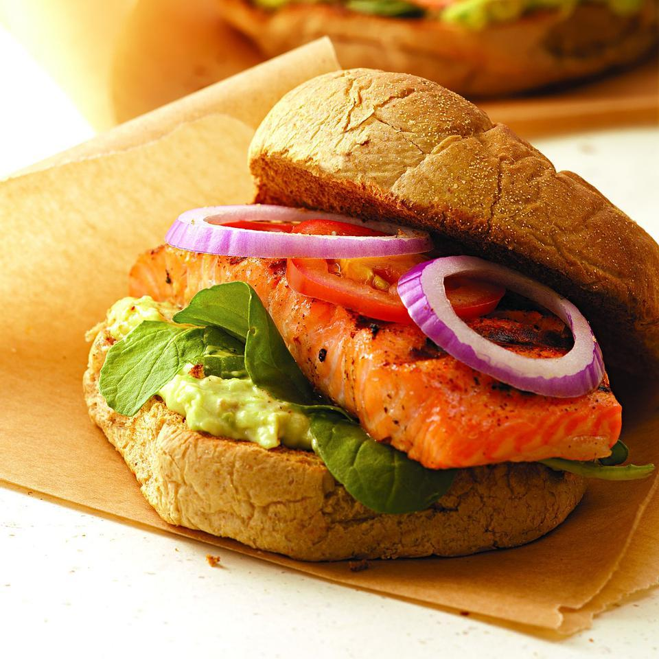 Blackened salmon is great in a sandwich with a spread of mashed avocado and low-fat mayonnaise plus peppery arugula leaves, cool tomato slices and zesty red onion. We grill our Cajun-style salmon so there is no need for any added cooking oil. Catfish makes an excellent stand-in for the salmon but you'll want to use a grill basket if you have one to keep the fish from breaking apart.