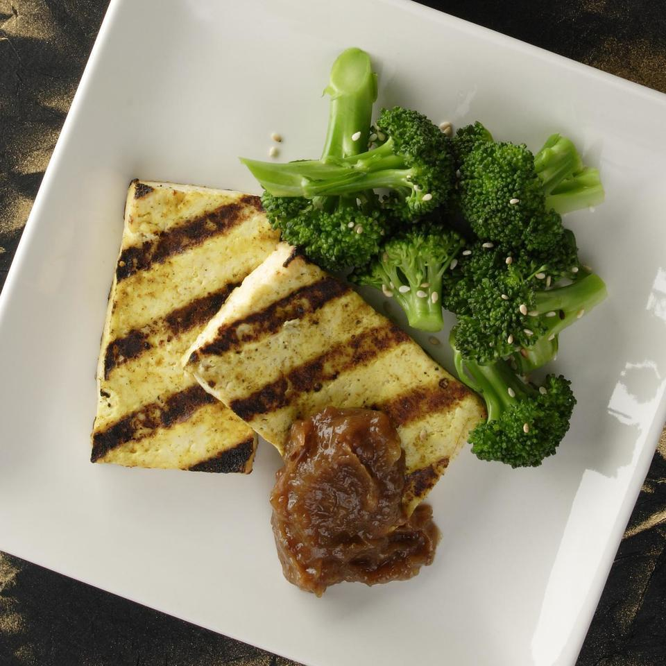Firm tofu is well suited for the grill because it does not fall apart. Seasoned with curry powder, the grilled tofu is not only filling, but also refreshing with its complementary sweet, spicy and tangy tamarind chutney served on the side for dipping. You may have extra chutney left over; serve it with grilled chicken or pork.