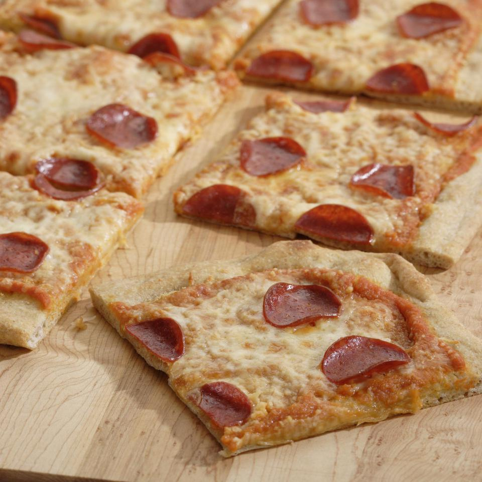 Pepperoni pizza gets a healthful makeover with whole-wheat pizza dough and a flavorful tomato sauce that, thanks to the addition of pumpkin puree, provides extra beta carotene and fiber. We've topped the pie with low-fat turkey pepperoni, but if you like, use your favorite sliced vegetables instead.