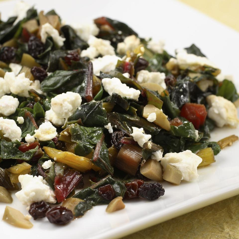 Chard with Green Olives, Currants & Goat Cheese EatingWell Test Kitchen