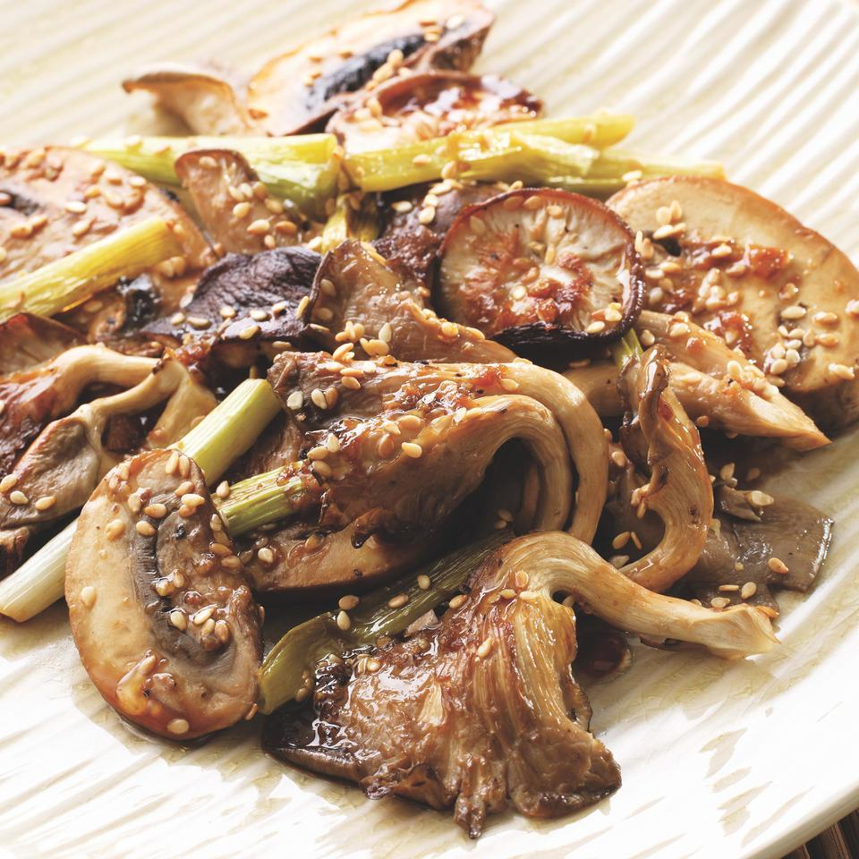 Roasting brings out the natural sweetness of mushrooms. Here they are paired with full-flavored sesame oil, ginger, garlic and scallions. Using a variety of mixed mushrooms makes this dish special (and delicious). Serve with Ginger-Steamed Fish with Troy's Hana-Style Sauce and rice noodles.