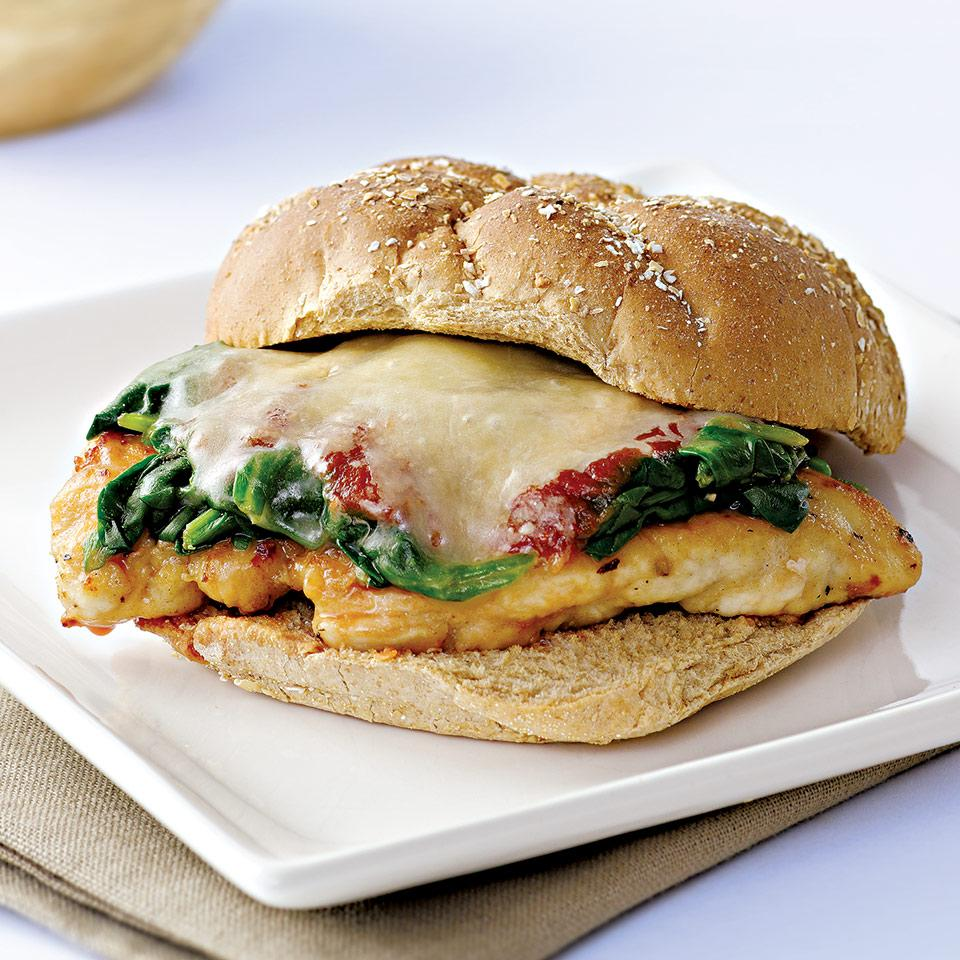 "You may disagree on whether the chicken parm sandwich should be known as a ""sub,"" ""hoagie"" or ""grinder,"" but who doesn't love this neighborhood-deli classic? We've added some spinach and done away with all the greasy breading to make it more healthy. Make it a meal: The sandwich is filling and complete on its own, but add some crunch with carrots, celery and cucumbers on the side. Source: EatingWell Magazine, December 2006"