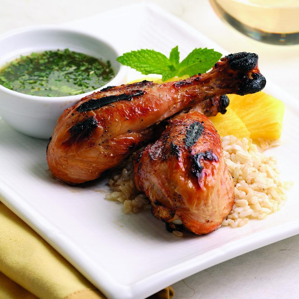 """Chicken drumsticks stay deliciously moist when grilled--even with the skin removed. Minty sweet-and-sour dipping sauce adds a refreshing twist to """"ordinary"""" grilled chicken. Make it a meal: Serve with brown rice and slices of fresh pineapple."""