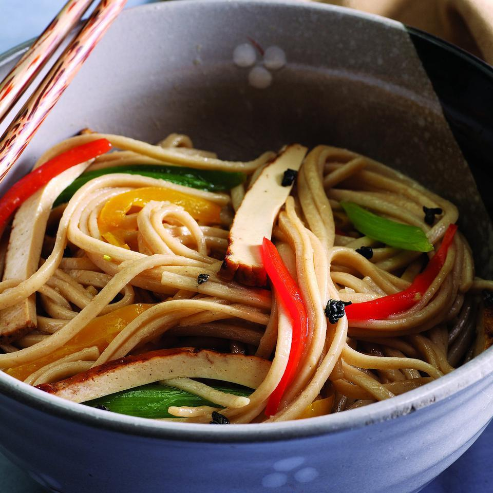 Perfect for a hot summer's night, baked tofu, bell peppers and scallions are stir-fried with udon noodles in this quick and easy dish. Source: EatingWell Magazine, July/August 2007