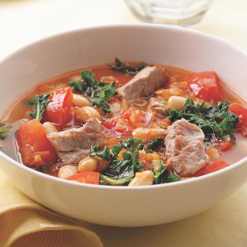 Kale is matched up here with white beans and chunks of lean pork tenderloin to create a soup that's satisfying and quick to make. Smoked paprika gives the soup a Spanish flair so some warm bread and sliced Manchego cheese would go well on the side.