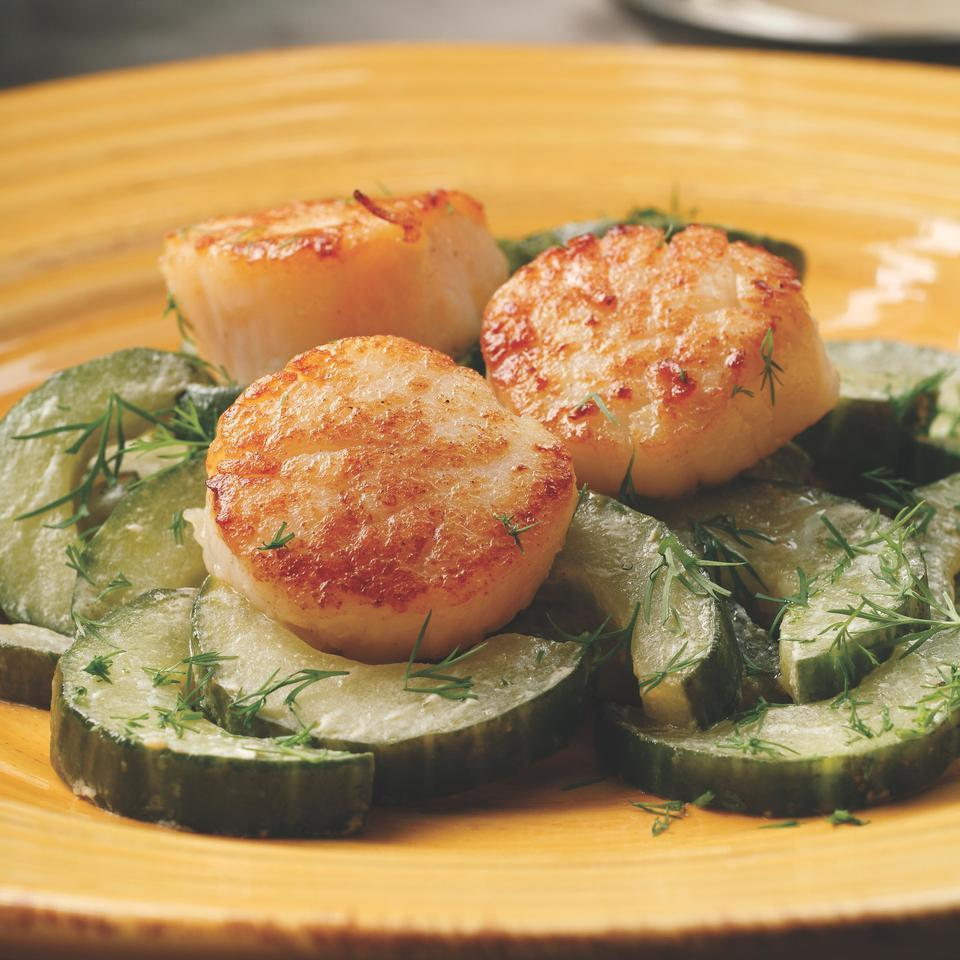 Sweet sea scallops pair beautifully with lightly sauteed cucumbers. Try adding a handful of julienned snow peas to the cucumbers, for extra crunch. Serve simply with crusty bread or a few boiled new potatoes.